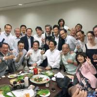 Abe switches from business dinners to lunches after drawing fire for partying during rain disaster