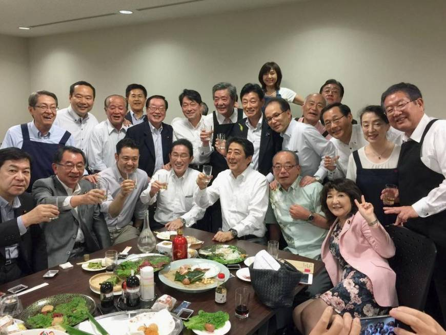 Abe and LDP under fire for holding party amid torrential rain warnings