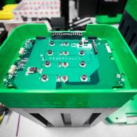 A circuit board sits on top of lithium-ion battery cells at the Powervault Ltd. office in London in June.   BLOOMBERG