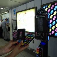 Portable chargers are shown Wednesday at Shinbashi Station with a dock station in the background. | KANTARO KOMIYA