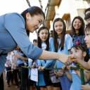 Princess Mako shakes hands with children at a Japanese migration facility in Londrina, Brazil, on Thursday.