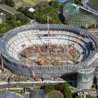 The National Stadium, the main venue for the 2020 Tokyo Games, under construction in April. | KYODO