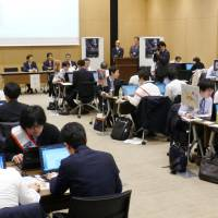 Officials from central government ministries participate in an exercise in Minato Ward, Tokyo, on March 16, to prepare for the possibility of cyberattacks during the 2020 Tokyo Olympics and Paralympics. | KYODO