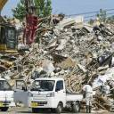 Trash and debris is seen piled up at a makeshift garbage disposal site in the Mabicho district in Kurashiki, Okayama Prefecture, on Sunday.