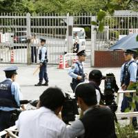 Police officers stand guard in front of the Tokyo Detention House on Thursday in Katsushika Ward, Tokyo. | KYODO