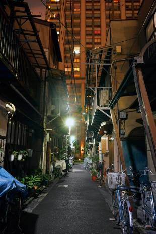 Residential towers and traditional wooden nagaya (row houses) coexist in Tsukishima, a reclaimed island in Tokyo
