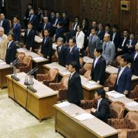 Liberal Democratic Party lawmakers stand up Wednesday at an Upper House committee to vote for a bill to increase the number of Upper House seats by six. | KYODO