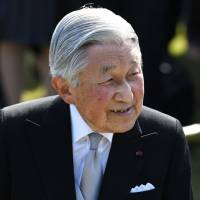 Emperor Akihito resumes official duties after bout of nausea
