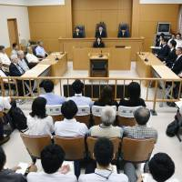 The Kochi District Court sits in session on Friday before it rejected a damages suit filed by former fishermen and their families claiming the fishermen were exposed to radiation in the 1954 U.S. hydrogen bomb tests in the Pacific. | KYODO