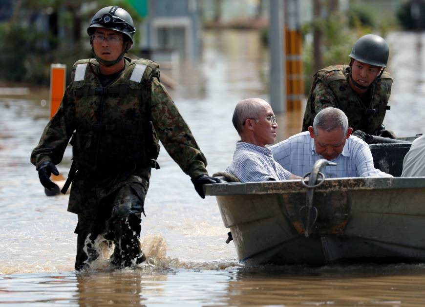 Self-Defense Force soldiers rescue people from a flooded area of Kurashiki, Okayama Prefecture, on Sunday.