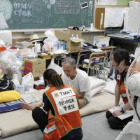 At shelters in western Japan, medical workers keep close eye on thousands of evacuees