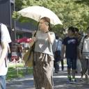 People are seen walking in Nagoya on Sunday. In many parts of the country,  when the mercury exceeded 35 C.