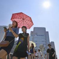 The mercury continued to hover well over 35 C in many areas of Japan on Thursday. | KYODO