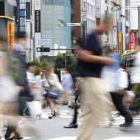 People crowd a street near Shinjuku Station. A variety of opinions were heard from people interviewed in Shinjuku about hikikomori, or those who shut themselves in from society. | KYODO