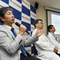 Kyoto University professor Jun Takahashi tells a news conference in the city Monday that the university will begin clinical tests this week using induced pluripotent stem cells to treat Parkinson's disease. | KYODO