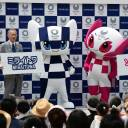 Olympic organizing committee chief Yoshiro Mori (third from left) and Tokyo Gov. Yuriko Koike (right) announce the names of the mascots for the Tokyo Games, Miraitowa and Someity, during their debut in Tokyo on Sunday.