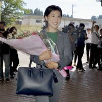 Japan's youngest town mayor welcomed on first day in office