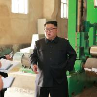 North Korean leader Kim Jong Un tours a factory in the city of Sinuiju in this undated photo released July 2. | REUTERS