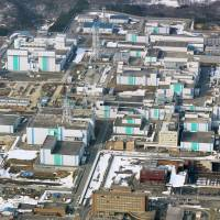 The Rokkasho plant in Aomori Prefecture, a key pillar of the country's nuclear fuel recycling policy, is seen in March 2014. | KYODO