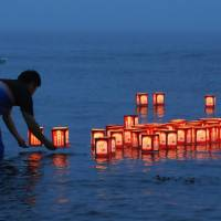 Candles are lit on Okushiri Island off the coast of Hokkaido on Thursday, to commemorate the 25th anniversary of a magnitude 7.8 earthquake and tsunami that left a total of 230 people dead or missing across the northern Japan prefectures of Hokkaido and Aomori. | KYODO