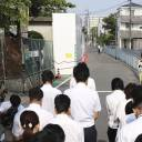 Teachers at Juei Elementary School in the Osaka Prefecture city of Takatsuki offer silent prayers Wednesday where a concrete-block wall collapsed in the June 18 earthquake, killing 9-year-old Rina Miyake.