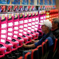 Already in decline, Japan's pachinko industry now braces for gambling-addiction regulations