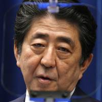 Prime Minister Shinzo Abe delivers a speech during a news conference at the Prime Minister's Office in Tokyo on Friday. | AP