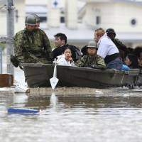 At least 50 dead and 50 missing as heavy rains continue to lash western Japan