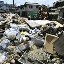 Debris from the recent rain disaster is seen piled up in the Mabi district of Kurashiki, Okayama Prefecture, on Friday. Damage to the agricultural, forestry and fisheries industries in western Japan was estimated at ¥64.8 billion as of Thursday.