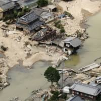 Rescuers race against time as death toll in western Japan floods rises to at least 176