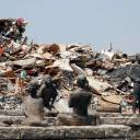 Household waste collected in the wake of the heavy flooding in western Japan is piled up at a temporary collection site in Kurashiki, Okayama Prefecture, on Saturday.