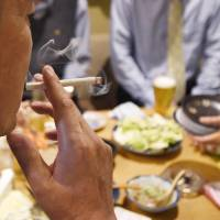 The Diet on Wednesday passed an amendment banning smoking in public facilities for the first time. | KYODO