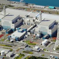 The Kashiwazaki-Kariwa nuclear plant in Niigata Prefecture is seen in this aerial photo taken in September. | KYODO