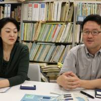 Chihei Suzuki (right) and Maki Sakamoto, both from the Office for World Cultural Heritage of Japan's Cultural Affairs Agency, are interviewed on June 21. | KYODO