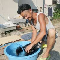 Well water helping residents and volunteers alike cope with cleanup in western Japan