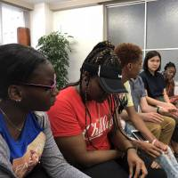 One step beyond: Eric Jordan (right) and students from New York's Frederick Douglass Academy VII High School take part in a discussion at Ginza Hub in Tokyo. The trip around Japan was partly financed by a crowdfunding campaign. | ROBERT MILLAR
