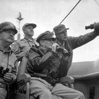 Gen. Douglas MacArthur, commander in chief of the U.N. Command (seated), observes the shelling of Incheon in September 1950. | PUBLIC DOMAIN