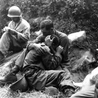 A U.S. soldier comforts a fellow infantryman who is grieving for a friend who was killed in action in South Korea in August 1950. | PUBLIC DOMAIN