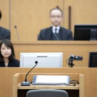 Crime and punishment: A judge sits facing the witness box at the Chiba District Court on June 14 following testimony by the suspected killer of an elementary school-age girl. | KYODO