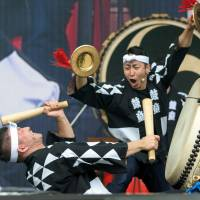 A couple of bangers: Japan's Kodo drummers wake the crowd up during a Sunday morning set on the Green Stage. | JAMES HADFIELD