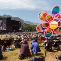 Put on a smile: While a typhoon caused havoc among campers at Fuji Rock on Saturday, the weather on Sunday had everyone smiling. | JAMES HADFIELD