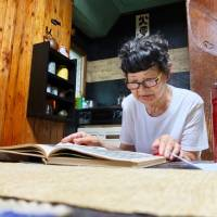 The written word: Yuyushi Furuta studies at her home in Tokyo, which is filled with items that help with her calligraphy.   KATHERINE WHATLEY