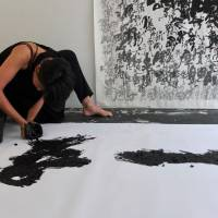 Body of work: Calligrapher and artist Soufu Honda uses her hands as brushes to create works of art. | KATHERINE WHATLEY