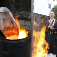 Photo finish: Akiyoshi Taniguchi, the head priest at Chohouin Temple, burns a test print (left) during a kuyō ceremony. The ritual is held to honor the dead, in this case that means photographic items that are no longer needed.