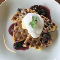 House special: Otto Knot's waffles, covered in raspberry sauce and ice cream. | J.J. O'DONOGHUE