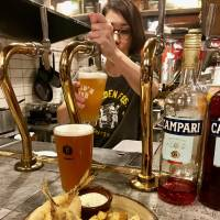 Fresh pour: Gold'n Bub serves 10 beers on tap, many from the on-site microbrewery Barbaric Works. | ROBBIE SWINNERTON