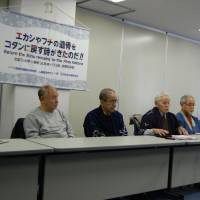 Kotan no Kai leader Yuji Shimizu speaks at a press conference after the second hearing in the group's lawsuit against Sapporo Medical University in the city's district court. Lawyer Morihiro Ichikawa is on the right.