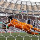 Big hands: Japan's Eiji Kawashima makes a save against Poland in Volgograd, Russia, on June 28.