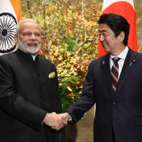 Prime Minister Shinzo Abe and his Indian counterpart, Narendra Modi, are deepening ties between Tokyo and New Delhi. | VIA BLOOMBERG
