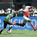 Kameli Soejima avoids a tackle by a Kenyan player to score a try during their Rugby World Cup Sevens match on Sunday at AT&T Park in San Francisco.